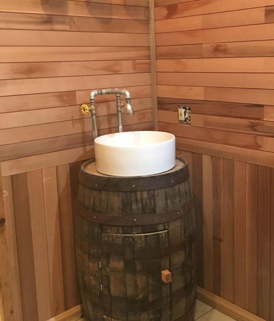Cedar bathroom with whiskey barrel sink